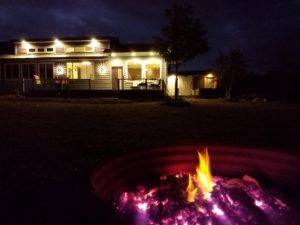 night scene - house and fire pit lit